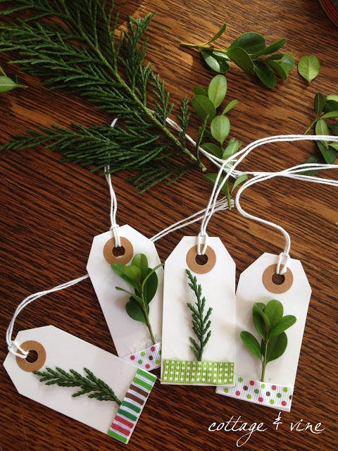 The labels came from Office Depot.  I always have a stockpile of ribbon in my gift wrapping arsenal, but decorative tape would also work.  The fresh cuttings are boxwood & leland cypress.  I used a glue gun to attach the trimmings. I used colored markers to add words to a few.  Super easy!