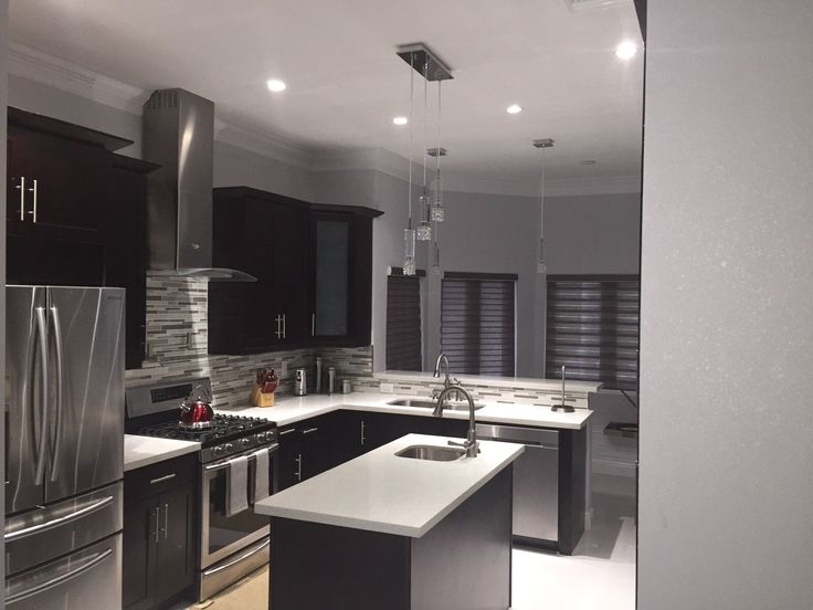 Espresso Shaker Cabinets And White Crystal Quartz Counter