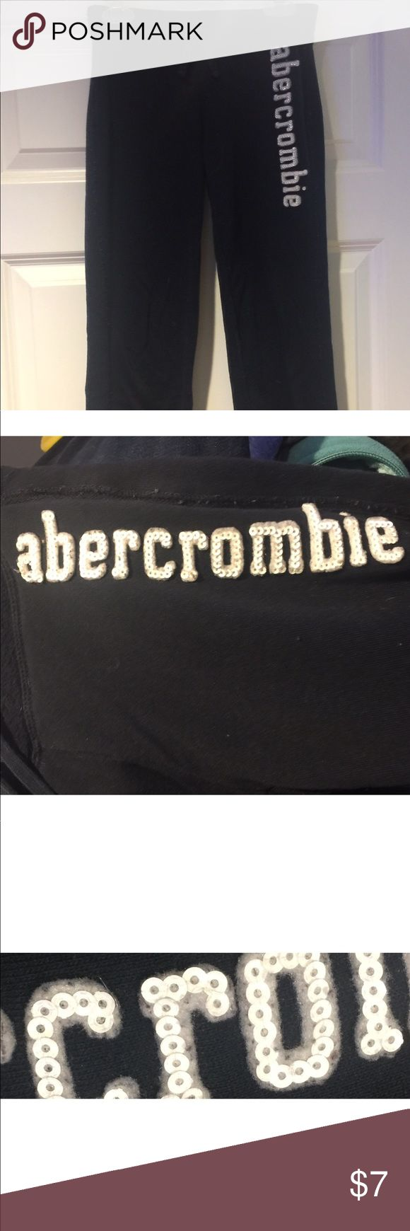 """Abercrombie Kids Girl's Sweatpants Abercrombie Kids girl's navy blue sweatpants, size 7/8. These cotton pants are soft & comfy. They have the name """"Abercrombie"""" in white sequins down the left leg in front (see pics 2 & 3; pic 3 is a close up in the sequins...ALL are intact & secure! 👍🏼) These sweats may or may not have some small """"pills"""" on them; it's just the nature of this fabric being washed. If you notice any, they can easily be removed with a sweater shaver😊. abercrombie kids Bottoms…"""