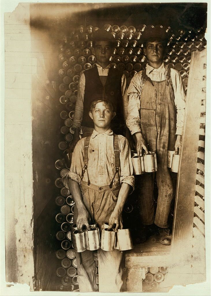 Boys Working in a Cannery, Indianapolis, Unloading freight cars full of new tomato cans. Aug., 1908.