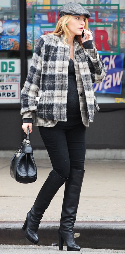 Blake Lively wearing layered plaid jackets with black skinny pants and knee-high, high-heeled boots, topped off with a newsboy cap.