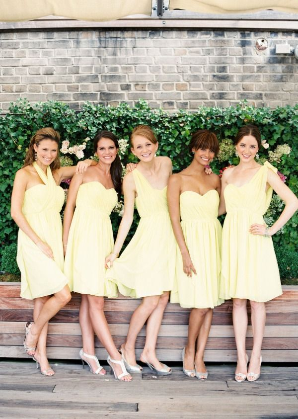 Pale yellow chiffon bridesmaid dresses for a spring wedding by Donna Morgan. via @Style Me Pretty