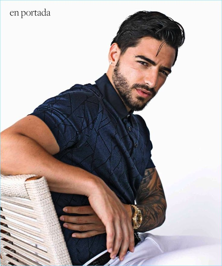 A sleek vision, Maluma sports a polo shirt, white pants, and belt by Hugo Boss.