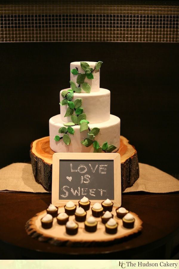 cake mounted on large slice of log, have small cheesecakes or cupcakes out for guests to eat until the cake gets cut