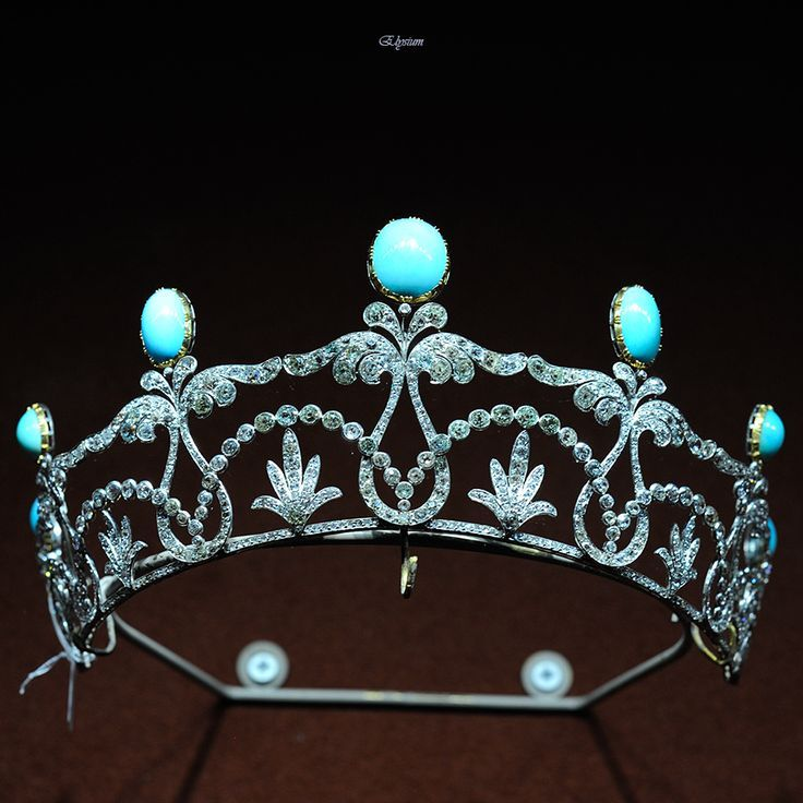 A diamond and turquoise belle epoque tiara, circa 1910. Featuring oval turquoise stones held on greek lyre-shaped diamond pinnacles with foliate scrolls on a diamond band; between which are circular diamonds in scalope-shapes arching over sprays of leaves in groups of five.