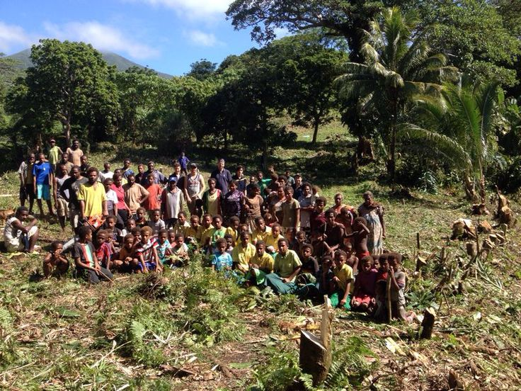 The megamone school community helping to clear the jungle so work on the new school can begin