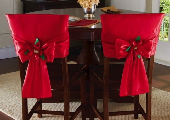 Red Holiday Bow Dining Chair Back Covers - Set of 2 red dining chair back covers feature a satiny finish and Christmas poinsettia in the center of the bow. Price: $14.99  Link    #Christmas