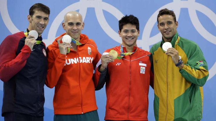 Day 221. 100m Butterfly Rio 2016: Singapore's Joseph Schooling takes gold over a remarkable three-way tie for silver between USA's Michael Phelps, Lészló Cseh of Hungary, and Chad le Clos of South Africa in 100 meter butterfly in Rio 2016. kurilane.com