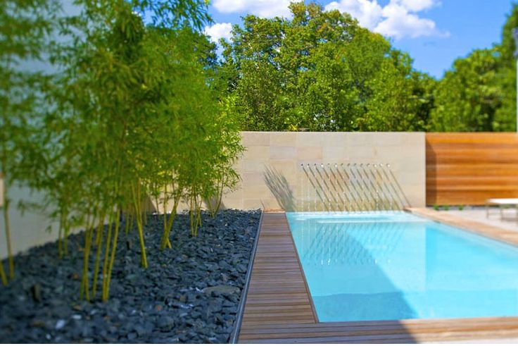Bamboo Garden With Black Basalt Gravel Next To Swimming