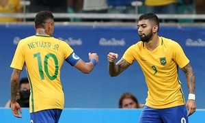 Neymar celebrates with Gabriel Barbosa after the forward known as Gabigol opened the scoring for Brazil against Denmark.