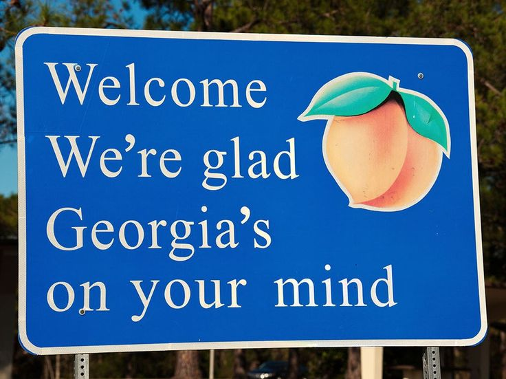 """Georgia On My Mind"" is the official song of the Peach State, so it's only fitting that a snippet of the lyrics (along with a fuzzy peach) ended up on its welcome signs."