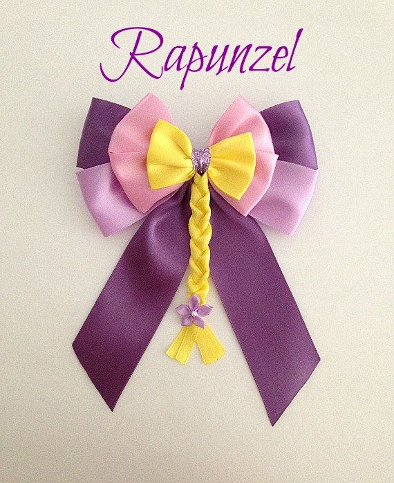 This listing is for a Disney inspired Rapunzel princess hair bow. It is handmade by me. The bow is made with satin ribbon. It measures about 4