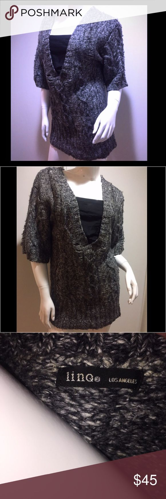 Linq Los Angeles thick S/S Lrg-knit sweater/tunic Beautiful & Unique. From the 1/2 sleeves to the longer style, the large knit style that appears heavy but feels light as a feather, this low elongated neck sweater/tunic is stunning. Photos do not capture the chic style or do this beauty justice! The material is a salt & peppered black & white with overall gray look. Very well made & goes with everything due. Don't miss this HTF piece for your wardrobe! Can be worn when it's winter with a…