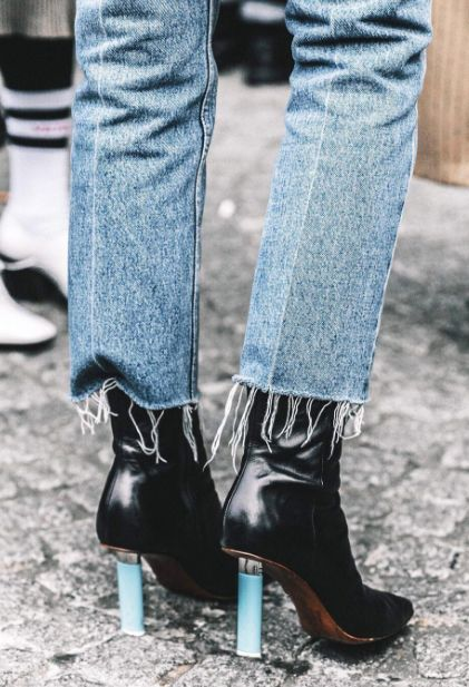 Shop now. Vetements ankle boots come with distinctive cigarette-lighter heels that demonstrate the label's high-end-meets-lowbrow aesthetic. Reissued from the VETEMENTS 1ST SEASON, the black leather and squared shape mean this pair will be a feature player in your wardrobe forever.