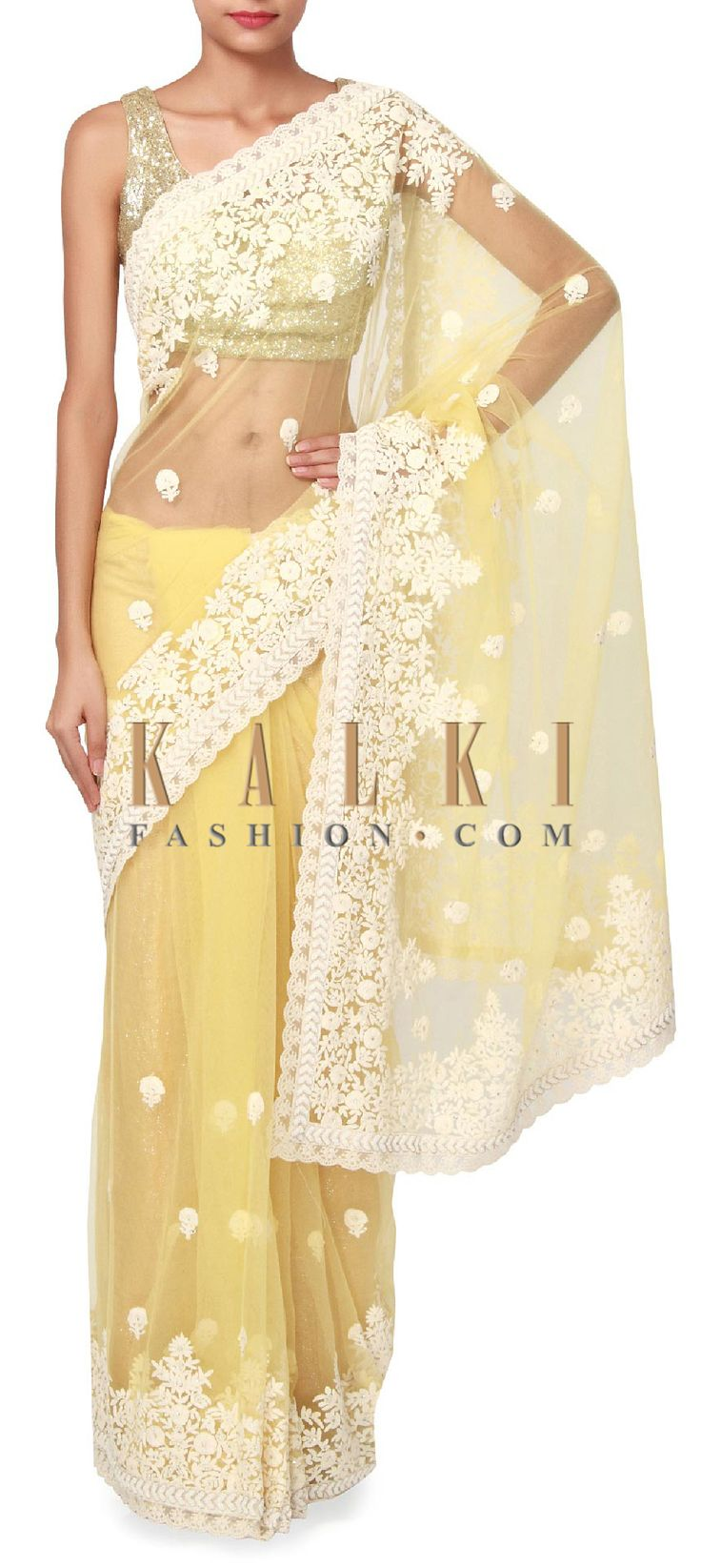 Buy Online from the link below. We ship worldwide (Free Shipping over US$100). Product SKU - 273495. Product Price - $219.00. Product link - http://www.kalkifashion.com/yellow-saree-enhanced-in-thread-embroider-only-on-kalki.html