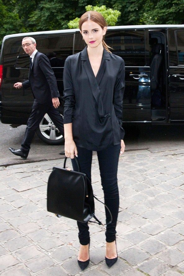 Emma in draped top and dark trousers. Paris #EmmaWatson #Armani