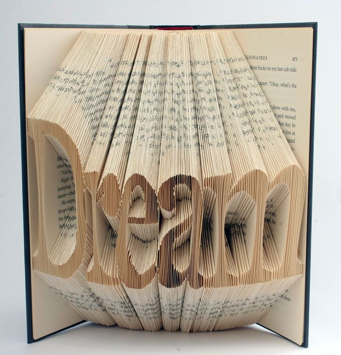I like the idea behind this whole thing. When you read a story it plays with your imagination and does in fact make you dream about what is going on. With this said, using the pages from a novel to spell 'Dream' is just great.