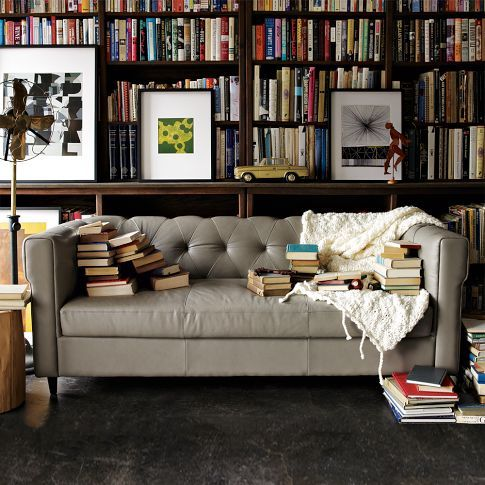 living room and books (Chester Tufted Leather Sofa)