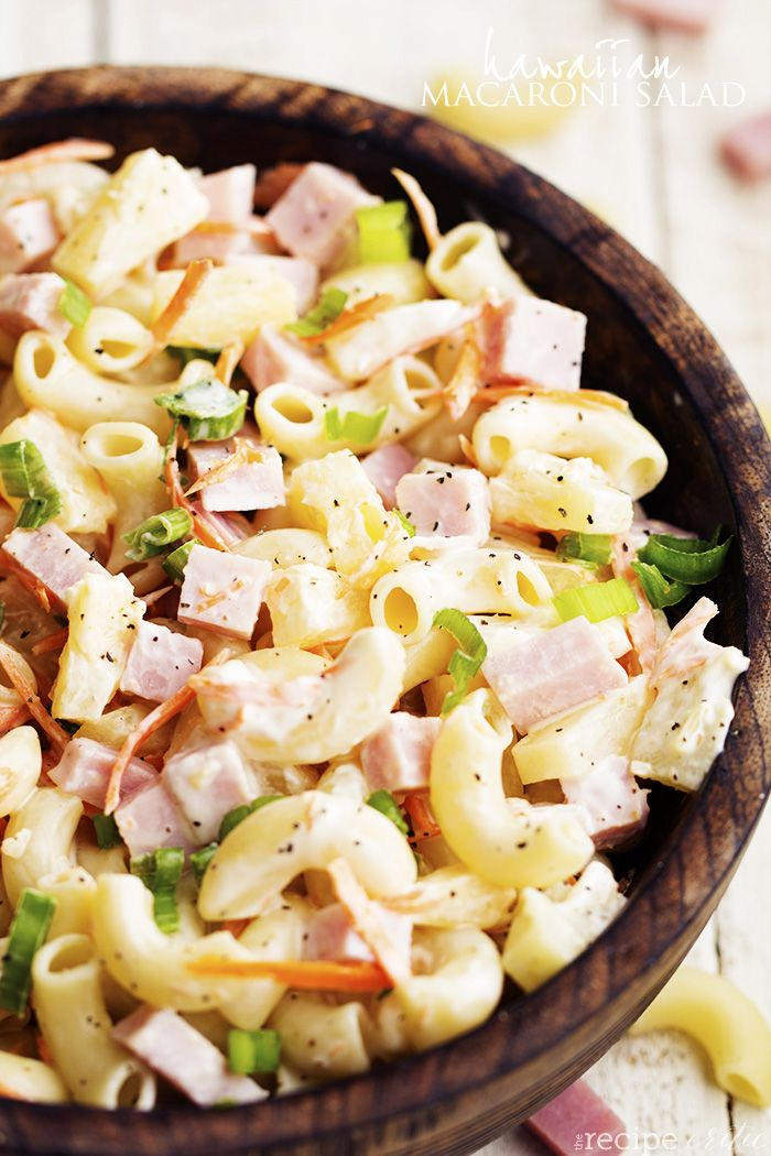 A delicious macaroni pasta salad with ham, pineapple, shredded carrots, and green onions.  It has such amazing flavor and it coated in a sweet and tangy pineapple dressing.   Isn't it crazy to thin...
