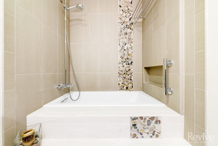A haven of relaxation, this shower-tub combo is both welcoming and accessible.