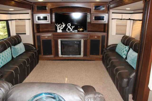"""2015 Used Grand Design Solitude 379FL Fifth Wheel in California CA.Recreational Vehicle, rv, 2015 Grand Design Solitude 379FL, For Sale BY OWNER, this luxurious living can be yours in this top of line, 2015 """"Grand Design Solitude 379 FL"""" ( front living room) 5th wheel. Perfect for living & entertaining with two 80"""" tri-fold sofas, a 58"""" theater sofa and a 50"""" LED HDTV with a fireplace below. The perfect setting for entertaining guests and enjoying a conversation with family and friends. A…"""