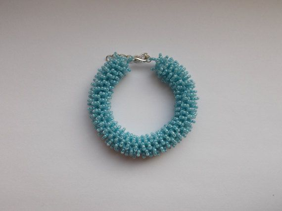 Check out this item in my Etsy shop https://www.etsy.com/listing/494420458/blue-puffy-bracelet