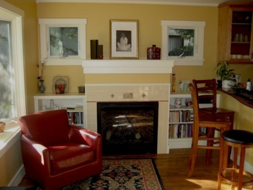 gives me ideas about connecting bookcases with fireplace and bar area