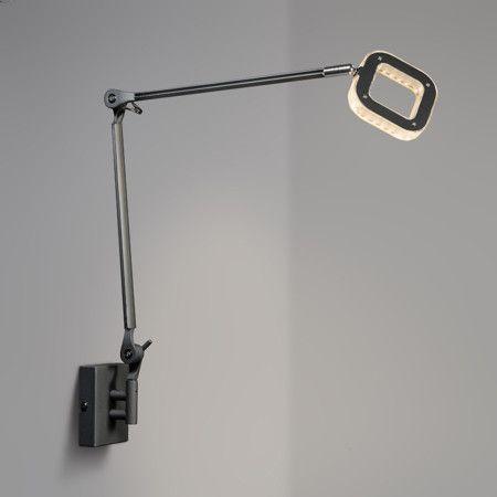 Lámpara de mesa OFICINA negra - Lámpara de oficina muy pràctica y versátil, ya que se puede utilizar como lámpara de pinza o aplique para la pared. El producto incluye los accesorios para ambas versiones. La lámpara está formada por dos brazos articulados con lo que se adapta a cualquier estancia