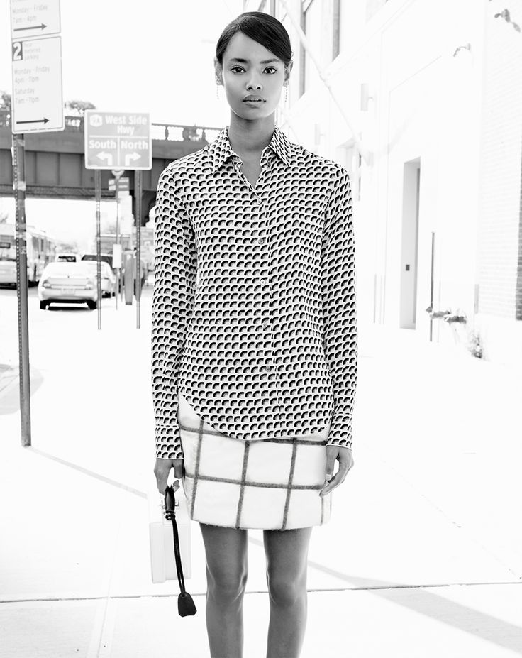 Today has been christened Work Like A Dog Day. Seriously. We choose not to look like one.Malaika Firth in a Marc Jacobs top, 3.1 Phillip Lim skirt, and Mark Cross bagMarc Jacobs fan-print button-up blouse, $550For information: marcjacobs.com