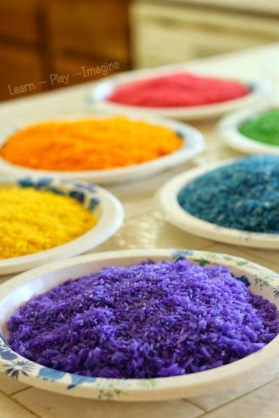 Making rainbow rice - it's so easy to dye rice for sensory play, and it lasts forever!