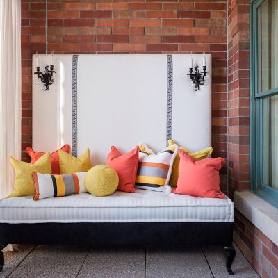 A Finer Touch Construction | the ROBERT. AFT, AFT Construction, Daybed, Brick Balcony, Brick, Balcony, Colorful Patio, Coral, Eclectic, Headboard, Iron Railing, Outdoor Patio Bench, Tufted Bench, Striped Pillows, Small Spaces, Victorian, Wall Sconces, Home Décor.