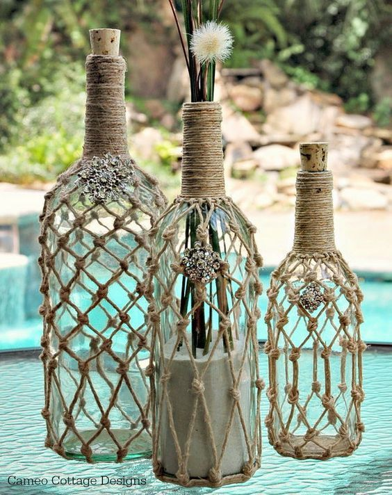Fantastic knotted jute net wine bottles. Check out more ideas on how to repurpose empty wine bottles here.