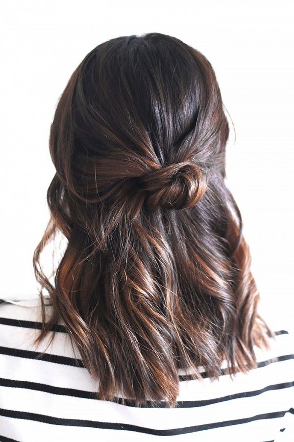 The half-up knot is a chic, and simple hairstyle that can be recreated in under three minutes.
