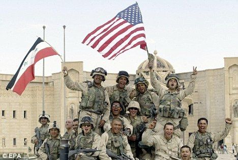Invaders: US marines wave US and Iraqi flags in front of al-Faruq Palace in the Iraqi city of Tikrit on April 14, 2003