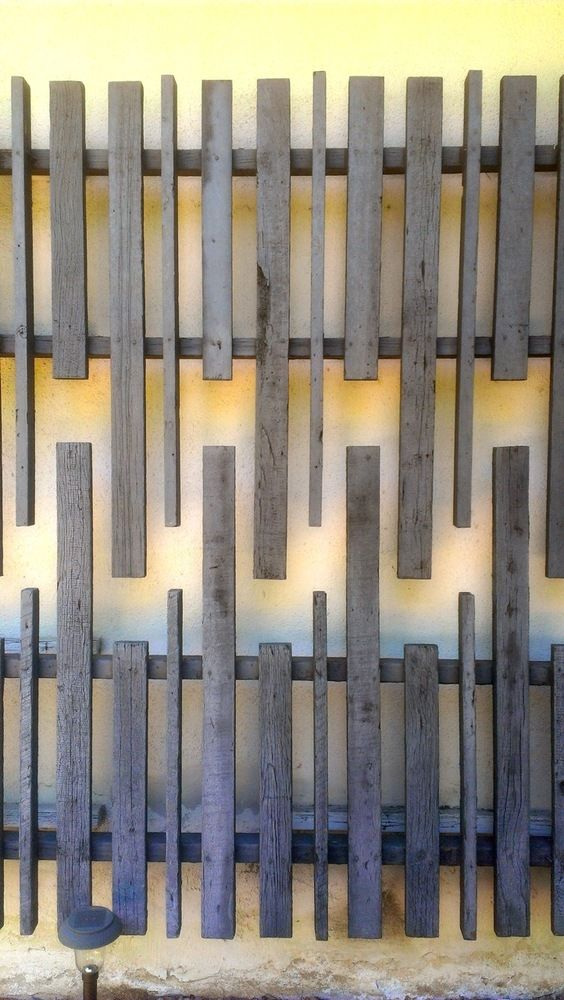 Weathered wood wall sculpture on mid century modern house in the Hollywood Hills