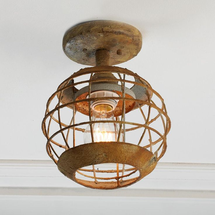 "Captain's Sandy Lantern Ceiling Light Fun and whimsical, this ceiling light works well with rustic, nautical or industrial inspired interiors with its weathered look. Great for a hallway, kids room, laundry room or kitchen. 9.5""Hx7.5""W. (1) 60W max, medium base socket"