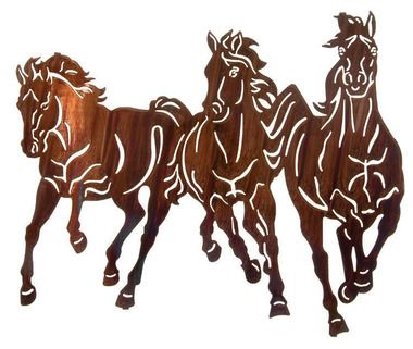 """Graced in the golden glow of a honey pinion finish, this western metal wall art captures the essence of """"""""Thunderstorm"""""""" as wild mustangs stampede across the wide open range. Another Kathryn Darling d"""