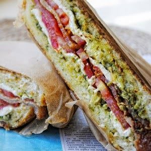 Bacon, pesto, tomato, mozzarella grilled sandwich : Original Recipe | Agnese Italian Recipes 1/3 cup prepared pesto 1 loaf ciabatta bread (about 1 pound), halved crosswise and lengthwise 2 medium tomatoes, sliced thin and salted 8 ounces fresh mozzarella   love it