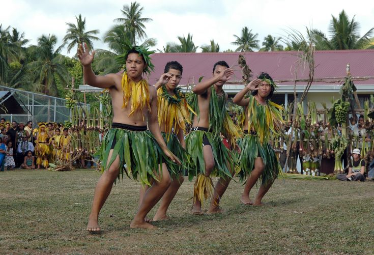 A Niuean dance group performs a traditional Polynesian dance to welcome tourists.