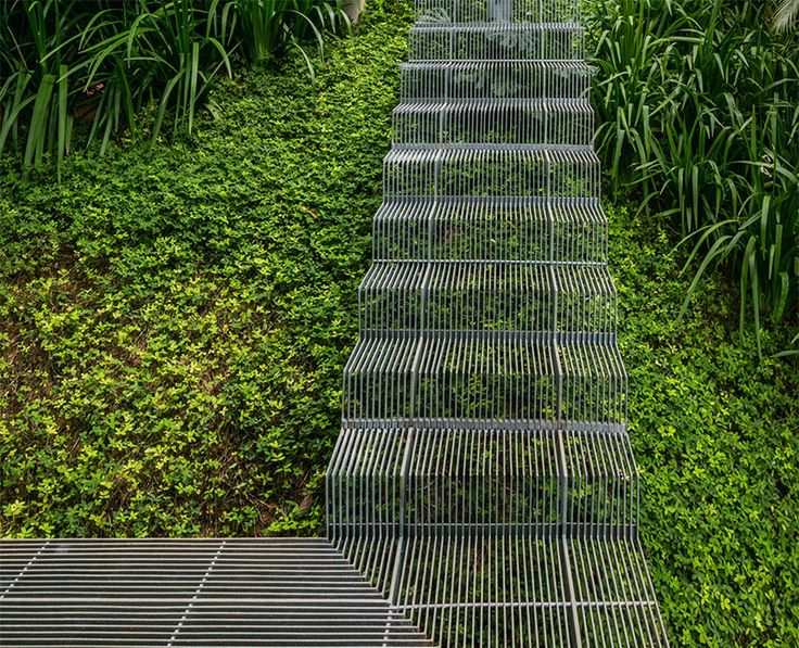 SPBR Arquitetos. The entire house features unique details in it that help make it environmentally friendly. But one of the most interesting design elements is the outdoor staircase