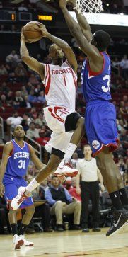 Houston Rockets forward Trevor Ariza (1) goes up for the basket against Philadelphia 76ers center Henry Sims (35) during the first half of an NBA basketball game at Toyota Center, Friday, Nov. 14, 2014, in Houston. ( Karen Warren / Houston Chronicle  )