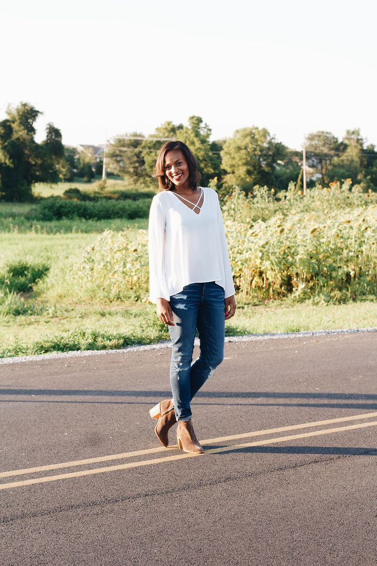 Flattering Fall Fashion and Fall Style. Featuring a cross front blouse, booties and ripped jeans. #fashionblogger
