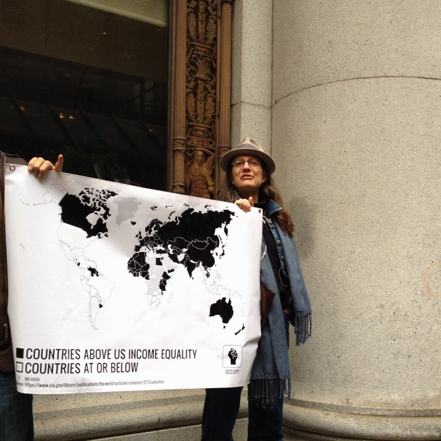 #OccupyDesign vinyl infographic map banner on the streets of SF showing global income inequality (I made this ^^) /// Our index is worse than US? Danggg