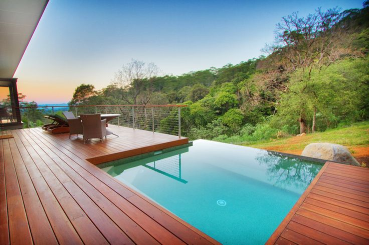 The warm hue of this timber deck partners perfectly with the turquoise drop pool -- what a sight! #craigmasseycarpentry #outdoorliving #timberdeck #inspiration