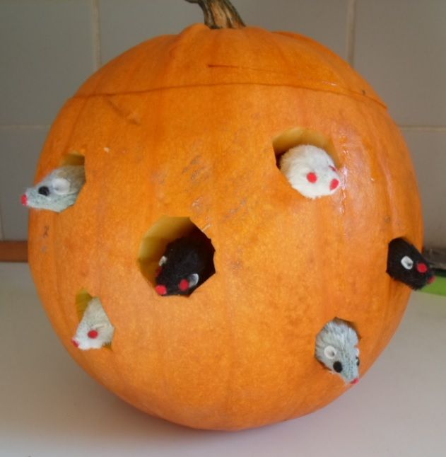 Carved pumpkin with mice.