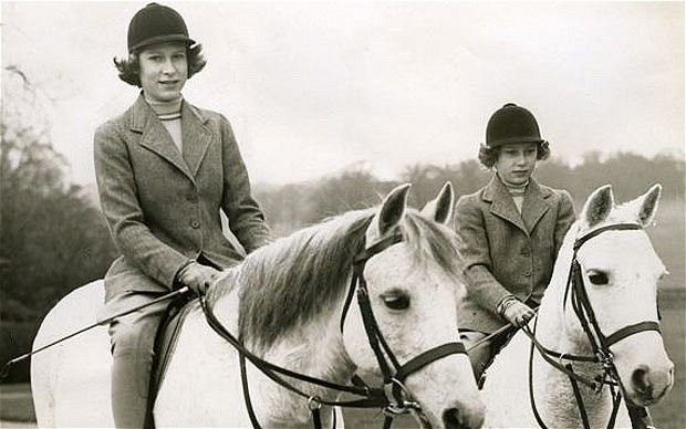 A young Queen Elizabeth and Princess Margaret out riding