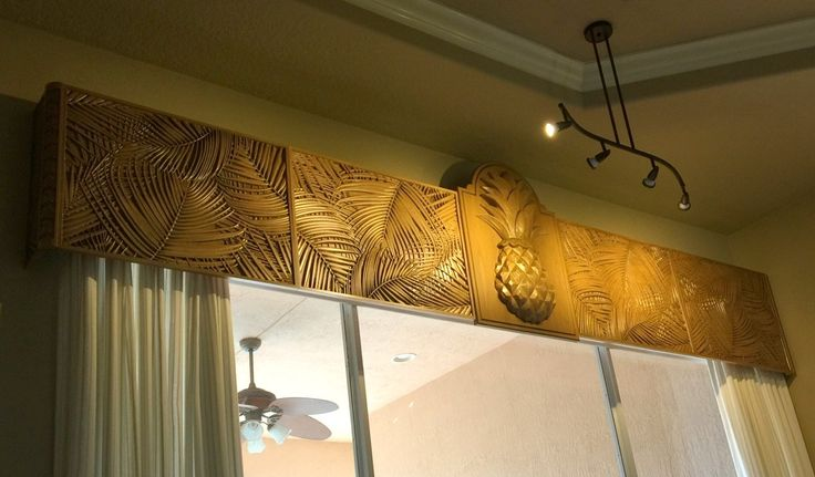 Carved Palm Leaf panels combined with a Pineapple keystone for a great tropical valance - Carved wood - close up
