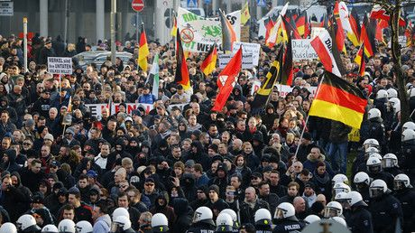 'German government's witch hunt against own population' - anti-immigrant AfD member - Supporters of anti-immigration right-wing movement PEGIDA (Patriotic Europeans Against the Islamisation of the West) take part in in demonstration march, in reaction to mass assaults on women on New Year's Eve, in Cologne, Germany © Wolfgang Rattay
