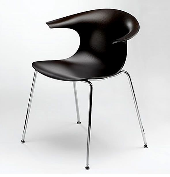 Loop 3D chair by Claus Breinholt. Modern chair which can be find in an office or in modern dining room either. The sit is made of wood which is bent to form a final shape. The frame is made of metal tubes. This chair seems to be simple and elegant in the same time.