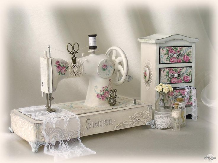 Old Singer with pretty decoupage update. Note the great idea using lace to hold the scissors/pins!